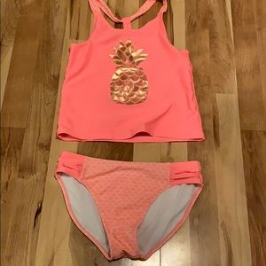 Pink swimsuit with gold pineapple